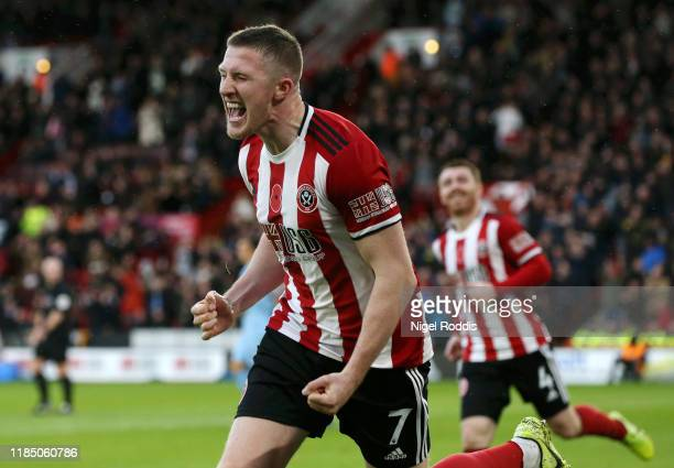John Lundstram of Sheffield United celebrates after scoring his team's second goal during the Premier League match between Sheffield United and...
