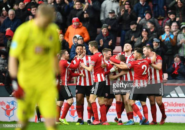 John Lundstram of Sheffield United celebrates with his team mates after scoring his team's second goal during the Premier League match between...