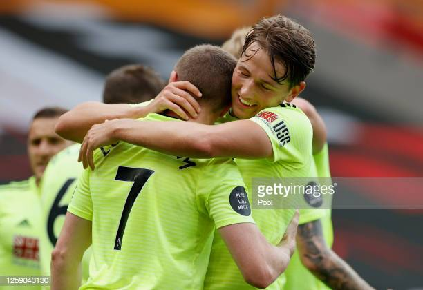 John Lundstram of Sheffield United celebrates with teammate Sander Berge after scoring his team's first goal during the Premier League match between...