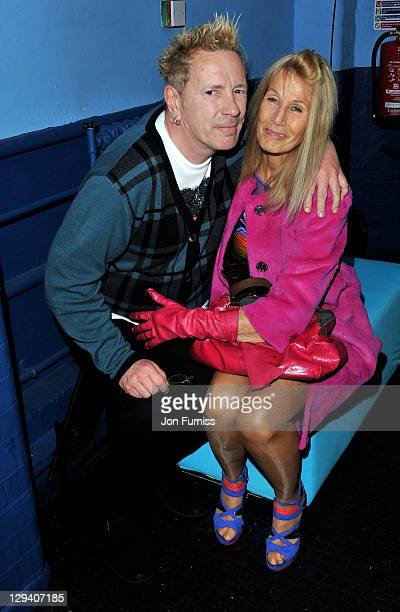 John Lydon and his wife Nora Forster pose backstage during the NME Awards 2011 at Brixton Academy on February 23 2011 in London England