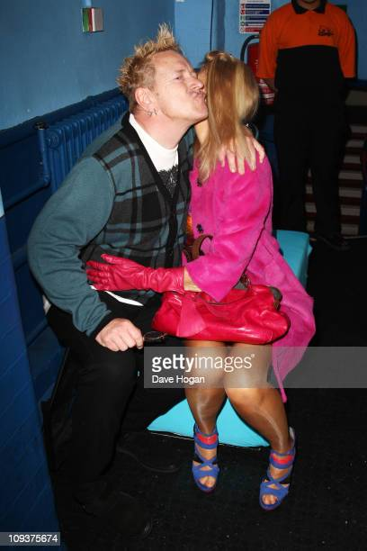John Lydon formally of The Sex Pistols and Pil and his wife Nora Forster pose in front of the winners boards at the Shockwaves NME Awards 2011 held...