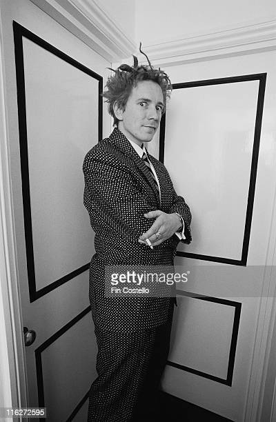 John Lydon singersongwriter with postpunk band Public Image Ltd posing for a portrait while holding a lit cigarette in Notting Hill London England...