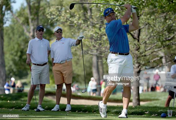 John Lynch hits his tee shot on the second hole as teammates Cooper Manning and John Elway look on during the Gardner Heidrick Pro-Am ahead of the...
