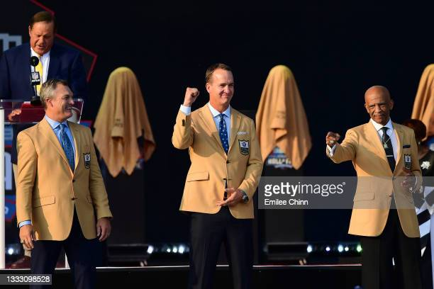 John Lynch, Peyton Manning and Drew Pearson during the NFL Hall of Fame Enshrinement Ceremony at Tom Benson Hall Of Fame Stadium on August 08, 2021...