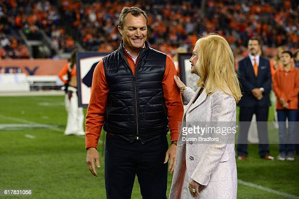 John Lynch talks with Annabel Bowlen at halftime when he is inducted to the Denver Broncos 'Ring of Fame' at Sports Authority Field at Mile High on...