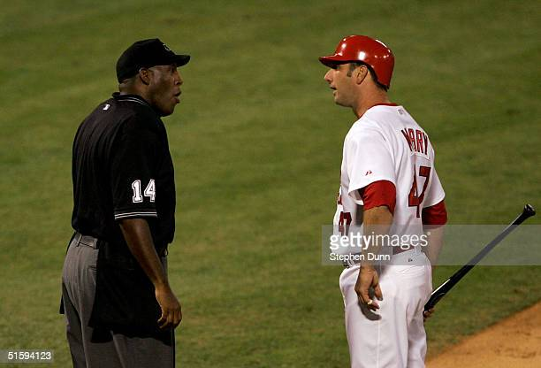John Mabry of the St Louis Cardinals argues a third strike call with home plate umpire Chuck Meriwether in the fifth inning against the Boston Red...