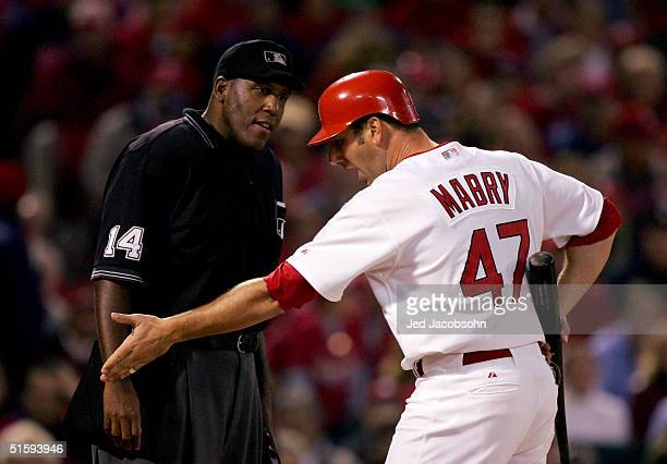 John Mabry of the St Louis Cardinals argues with home plate umpire Chuck Meriwether after being called out on strikes during game four of the World...