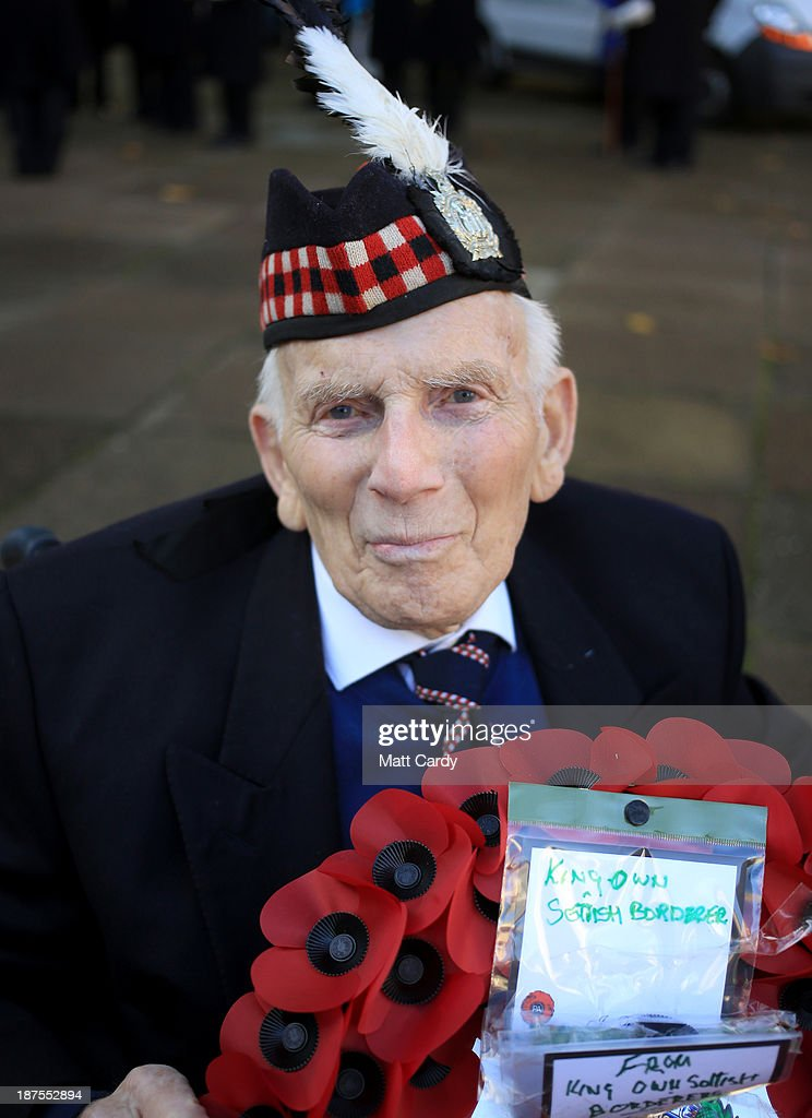 John MacDonald, 86, poses for a photograph as waits to lay a wreath from the The King's Own Scottish Borderers in front of the cenotaph at a Remembrance Day ceremony on November 10, 2013 in Bristol, England. People across the UK gathered to pay tribute to service personnel who have died in the two World Wars and subsequent conflicts, as part of the annual Remembrance Sunday ceremonies.
