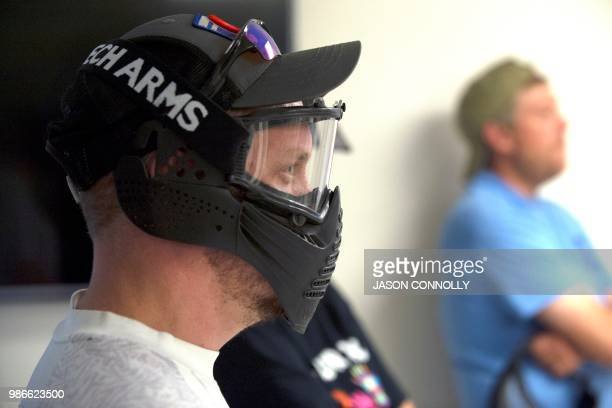 John MacFarlane a Colorado Springs high school physics teacher from Colorado school District 20 wears protective gear while participating in an...