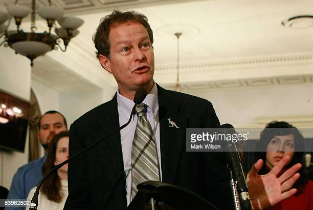 John Mackey, CEO of Whole Foods, speaks while surrounded by Whole Foods employees during a news conference on Capitol Hill, December 9, 2008 in...