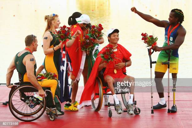 John Maclean and Kathryn Ross of Australia win the Silver medal, Zhou Yangjing and Shan Zilong of China win the Gold medal, Elton Santana and Josiane...