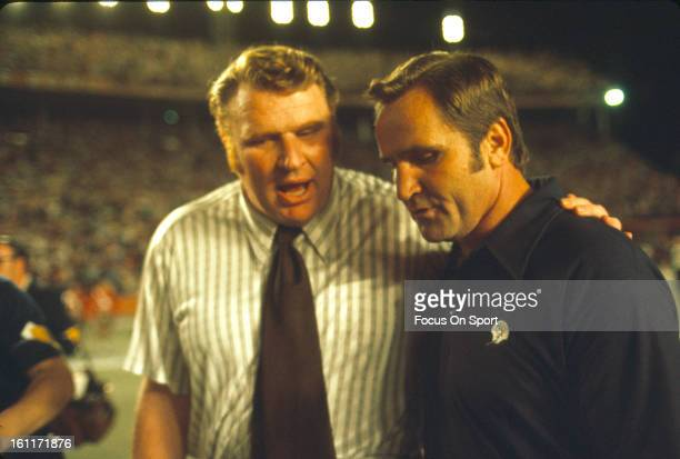 John Madden head coach of the Oakland Raiders left and Don Shula head coach of the Miami Dolphins right walks off the field together after an NFL...