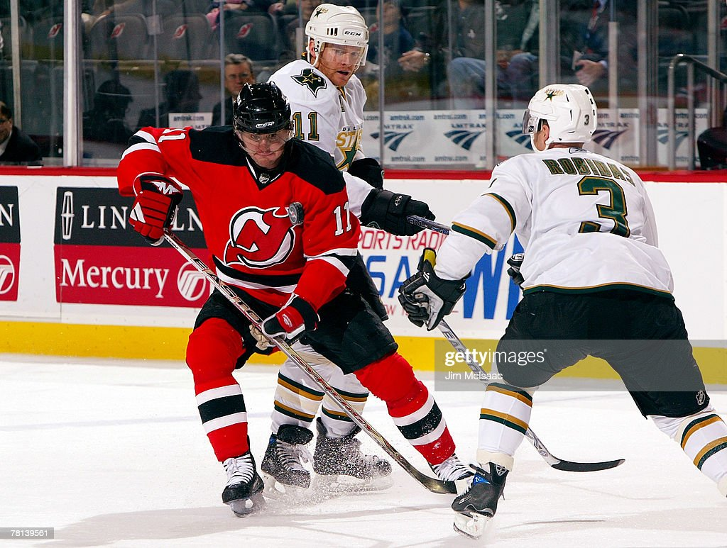 separation shoes c1720 4e91e John Madden of the New Jersey Devils plays the puck against ...