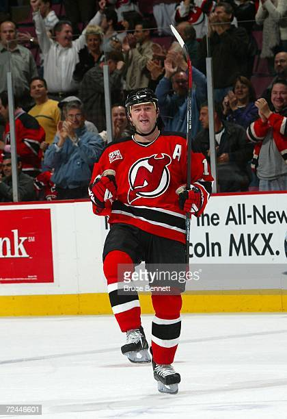 John Madden of the New Jersey Devils scores on the shootout to beat the Carolina Hurricanes on November 7 2006 at Continental Airlines Arena in East...