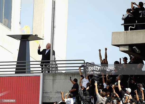 John Madden points to the sky after lighting a flame in the honor of Oakland Raiders owner Al Davis during halftime of their game against the...