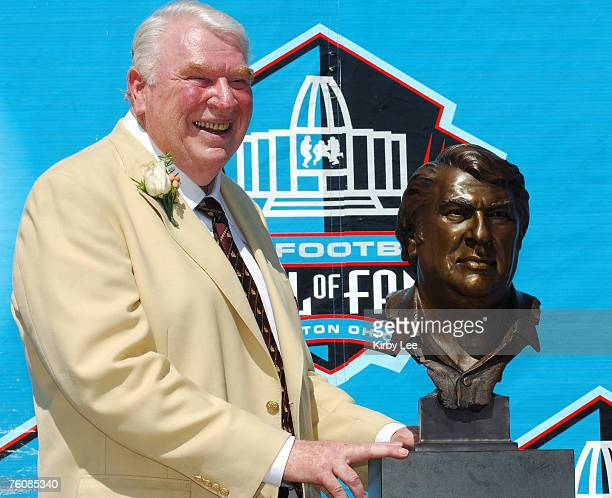 John Madden poses with bust at NFL Pro Football Hall of Fame Enshrinement at Fawcett Stadium in Canton Ohio on Saturday August 5 2006