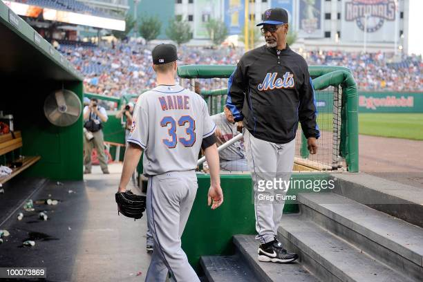 John Maine of the New York Mets talks to manager Jerry Manuel after being removed in the first inning of the game against the Washington Nationals at...