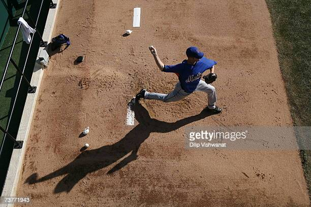 John Maine of the New York Mets warms up in the bullpen before the game against the St Louis Cardinals during their Opening Day game on April 1 2007...