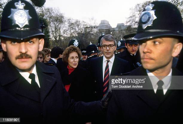John Major and his wife Norma take a stroll through St James Park surrounded by Metropolitan police officers during the November 1990 election...