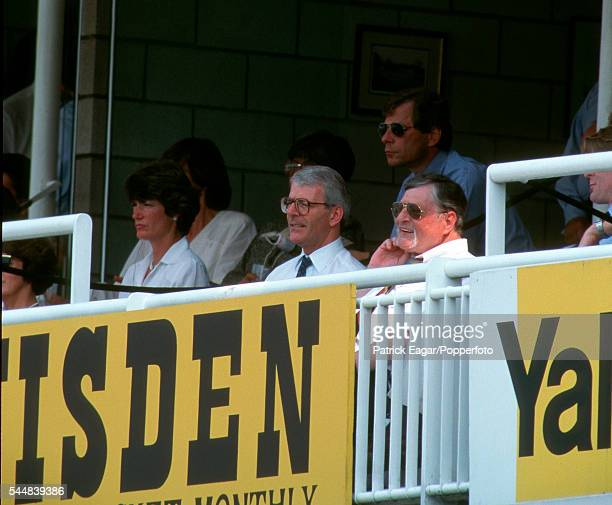 John Major joins Sir Paul Getty in his hospitality box at Lord's during the 1st Test match between England and South Africa at Lord's Cricket Ground...