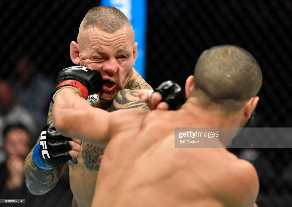 John Makdessi of Canada punches Ross Pearson of England in their lightweight bout during the UFC Fight Night event at Scotiabank Saddledome on July 28, 2018 in Calgary, Alberta, Canada.