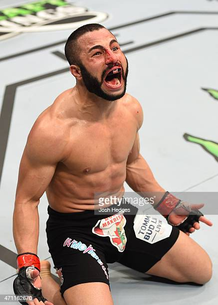 John Makdessi of Canada reacts after his TKO victory over Shane Campbell of the United States in their catchweight bout during the UFC 186 event at...