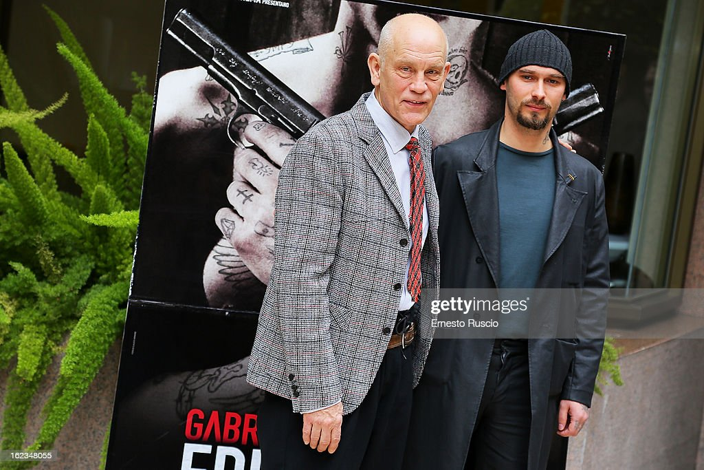 John Malkovich and writer Nicolai Lilin attend the 'Educazione Siberiana' photocall at Hotel Visconti Palace on February 22, 2013 in Rome, Italy.