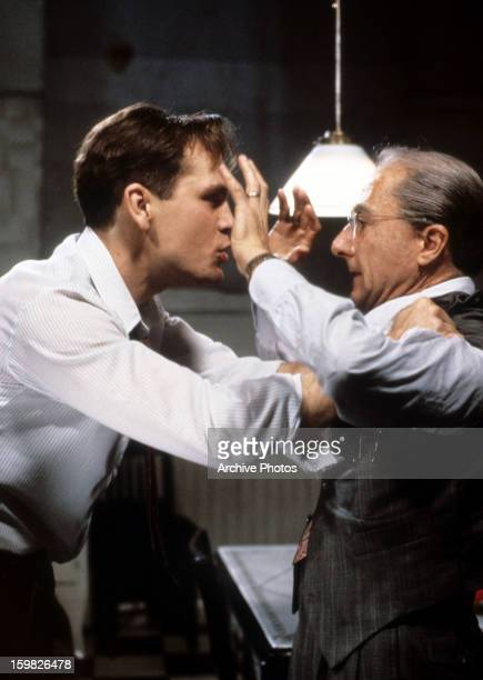 John Malkovich has his hands on Dustin Hoffman shoulders in a scene from the television movie 'Death Of A Salesman' 1985