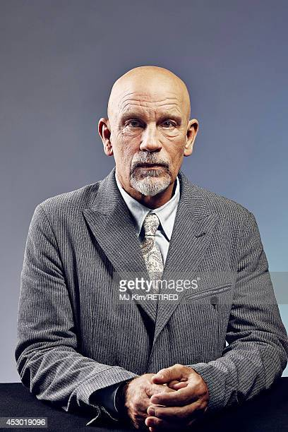 John Malkovich poses for a portrait at the Getty Images Portrait Studio powered by Samsung Galaxy at ComicCon International 2014 on July 24 2014 in...