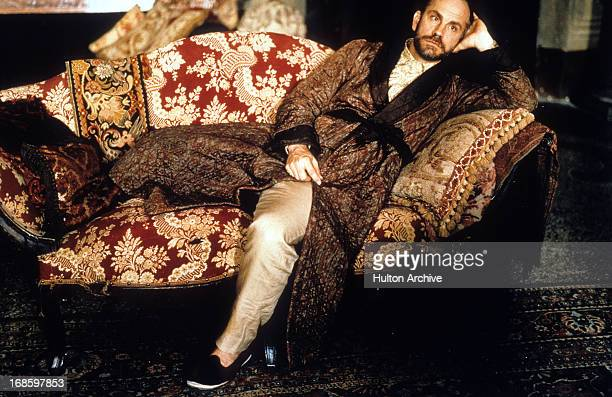 John Malkovich reclines on a couch in a scene from the film 'The Portrait Of A Lady' 1996