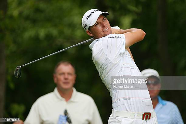 John Mallinger hits his tee shot on the second hole during the final round of the Wyndham Championship at Sedgefield Country Club on August 21, 2011...