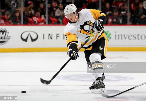 John Marino of the Pittsburgh Penguins passes the puck in the first period against the New Jersey Devils at Prudential Center on November 15 2019 in...