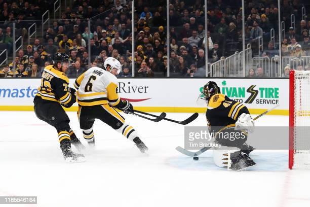 John Marino of the Pittsburgh Penguins scores a second period goal against Jaroslav Halak of the Boston Bruins at TD Garden on November 04 2019 in...