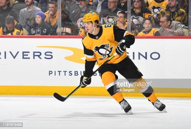 John Marino of the Pittsburgh Penguins skates against the Nashville Predators at PPG PAINTS Arena on December 28 2019 in Pittsburgh Pennsylvania