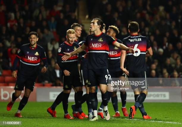 John Marquis of Doncaster Rovers celebrates as he scores his team's third goal wit team mates during the Sky Bet League One PlayOff Second Leg match...