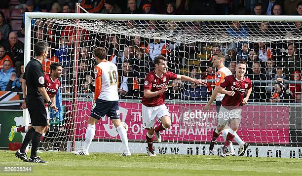 John Marquis of Northampton Town turns to celebrate after scoring his sides second goal during the Sky Bet League Two match between Northampton Town...