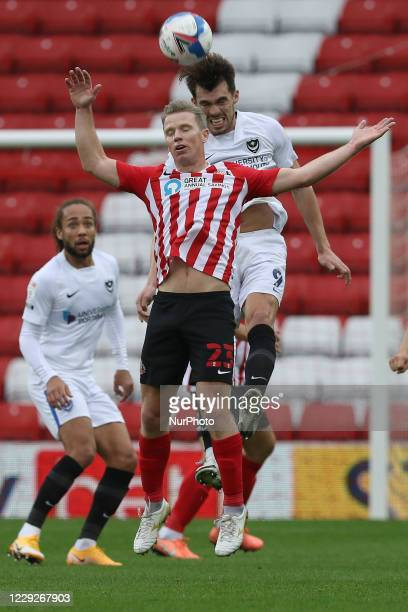 John Marquis of Portsmouth challenges Grant Leadbitter of Sunderland for a header during the Sky Bet League 1 match between Sunderland and Portsmouth...