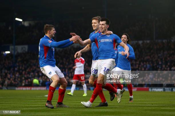 John Marquis of Portsmouth FC celebrates with teammates after scoring his team's second goal during the FA Cup Fourth Round match between Portsmouth...