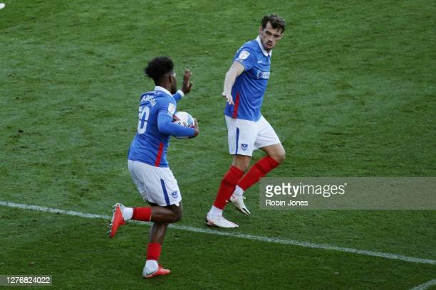 John Marquis of Portsmouth FC congratulates team-mate Ellis Harrison after he scores a goal to make it 2-1 during the Sky Bet League One match...
