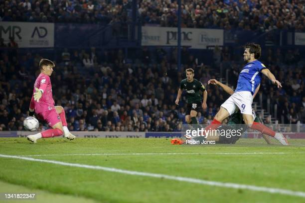 John Marquis of Portsmouth FC sees his shot saved by Michael Cooper of Plymouth Argyle during the Sky Bet League One match between Portsmouth and...
