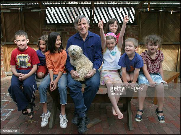 John Marsden and his dog Coco with some of the children from the North Fitzroy Community School where Marsden teaches one day a week 18 February 2005...