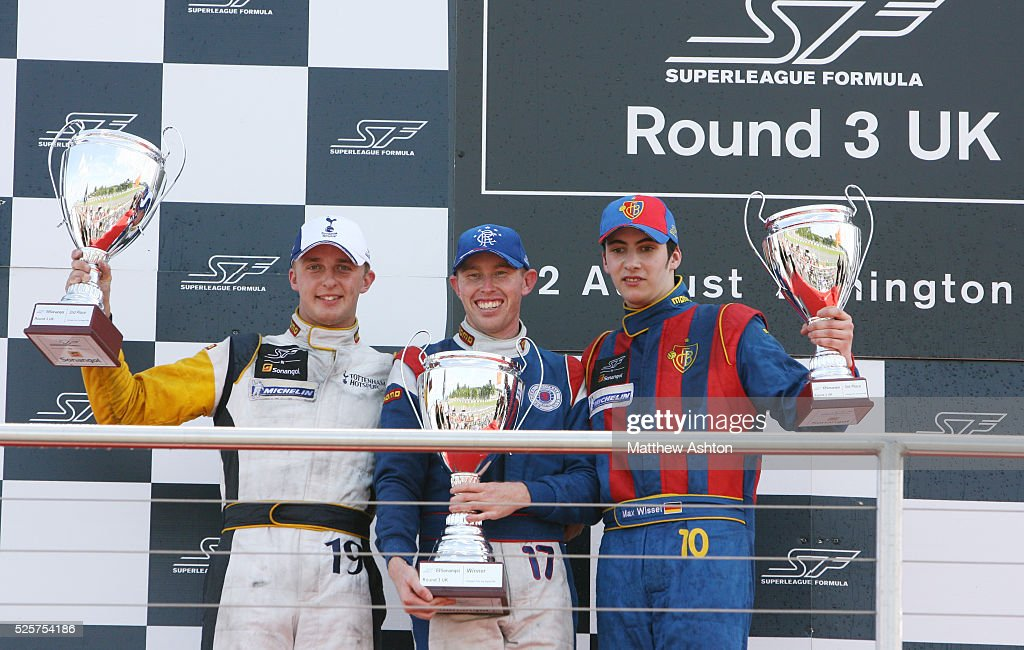 John Martin of Australia team Glasgow Rangers stands on the podium after the race with Craig Dolby of Tottenham Hotspur and Max Wissel of FC Basel
