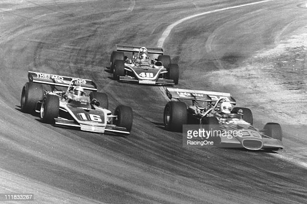 John Martin races with Johnny Rutherford as Jerry Grant trails during the Best Western 150 USAC Indy Car race at Phoenix International Raceway
