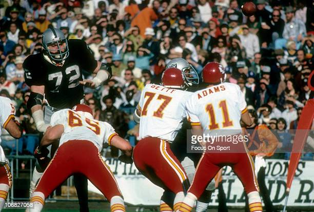 John Matuszak of the Oakland Raiders is blocked by Tom Condon of the Kansas City Chiefs during an NFL football game at the OaklandAlameda County...