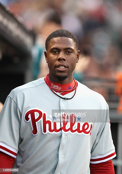 John Mayberry Jr #15 of the Philadelphia Phillies stands in the dugout before their game against the San Francisco Giants at ATT Park on April 17...