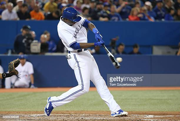 John Mayberry Jr #9 of the Toronto Blue Jays bats in the seventh inning during MLB game action against the Baltimore Orioles on September 26 2014 at...