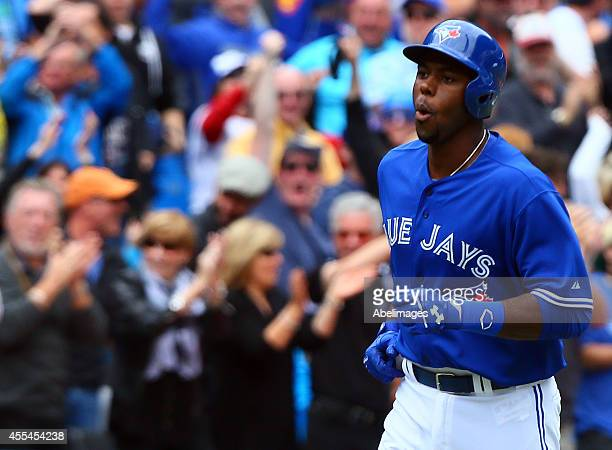 John Mayberry Jr #9 of the Toronto Blue Jays celebrates his home run in the 9th inning against the Tampa Bay Rays during MLB action at the Rogers...