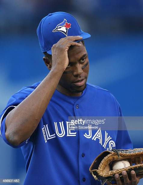 John Mayberry Jr #9 of the Toronto Blue Jays during MLB game action against the Baltimore Orioles on September 27 2014 at Rogers Centre in Toronto...
