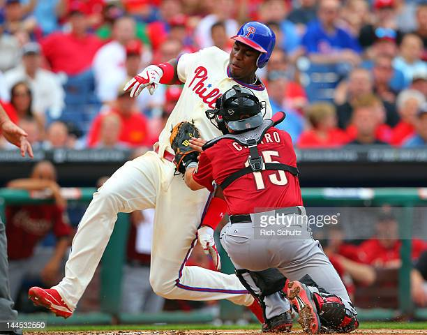 John Mayberry of the Philadelphia Phillies is tagged out at home by catcher Jason Castro of the Houston Astros for the final out of the fourth inning...
