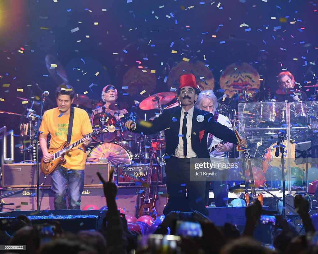 John Mayer and Bob Weir of Dead and Company perform with costumed guests at The Forum on December 31, 2015 in Inglewood, California.